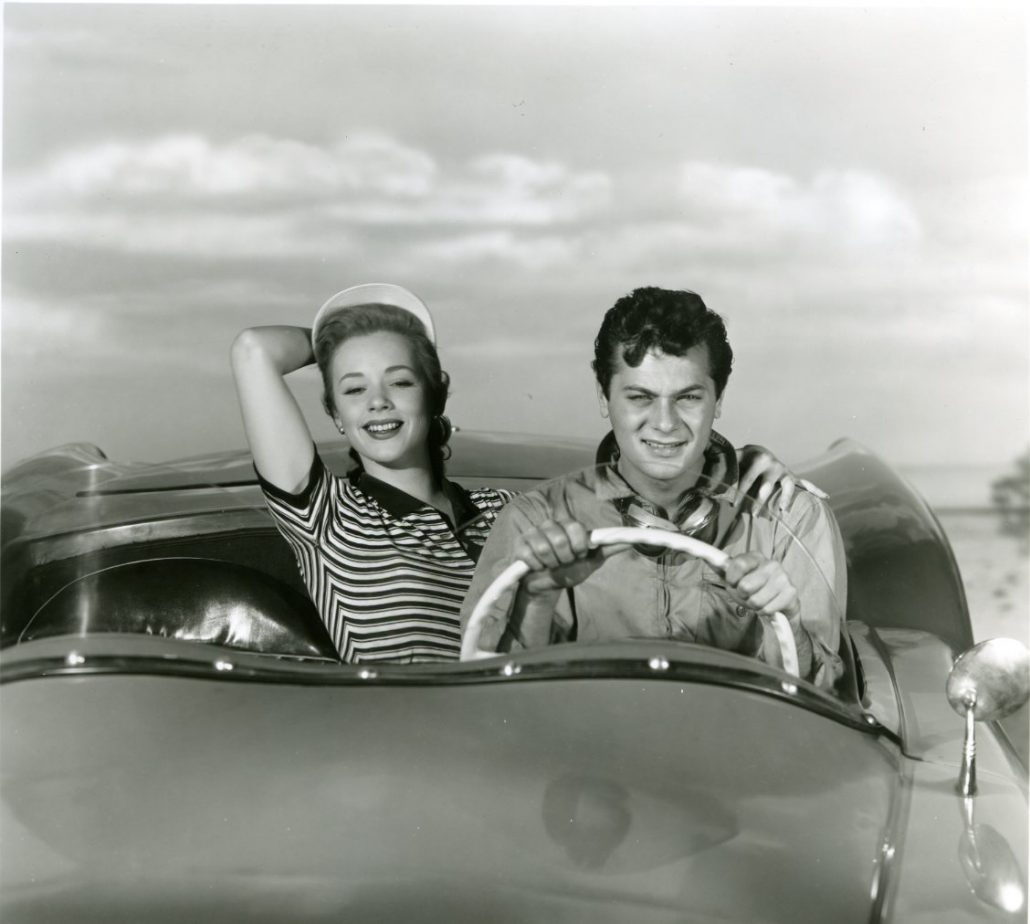 Tony Curtis at the Wheel With