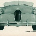 "Caption: Few people would point out that this car as being a Henry J.  Would you?  Body was sectioned 5"" and the top was removed completely.  The windshield is surrounded by a '37 Ford frame.  The grille bars are copper tubing, chrome plated.  Color of the restyled car is a medium blue."