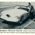 Caption: Designer Howard Darrin shows how doors slide into the fenders in his plastic Kaiser Darrin.