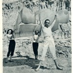 Caption: Unscathed body is held aloft by the girls to demonstrate its lack of weight.  They are Suzanne Alexander, Doreen Woodbury, and Maureen Stephenson.