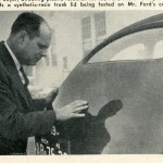 Caption: Robert Boyer, directing plastic research for the Ford Motor Company, inspects a synthetic-resin trunk lid being tested on Mr. Ford's car.