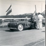 Enthusiast Mike Wittman snapped this picture of the Glasspar Racecar at Pebble Beach Back in 1953 when he was just 16 years old.  He's kept this picture all these years, and was kind enough to share this with our readers today.  He camped out overnight to see the race – right at Pebble Beach.  The picture was taken on Saturday – before the carbs caught on fire.