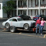 Atlas / Allied Car Found in Northern Oregon.  Merrill and Gerianne Powell Shown Next To Sports Car.